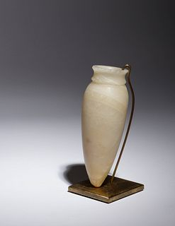 An Egyptian Alabaster Vessel Height 5 3/8 inches.