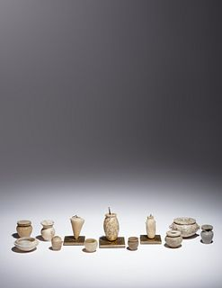 Twelve Egyptian Alabaster, Breccia and Other Stone Vessels Height of tallest example 2 5/8 inches.
