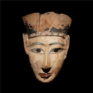 An Egyptian Painted Wood Mummy Mask Height 12 x width 8 1/8 inches.