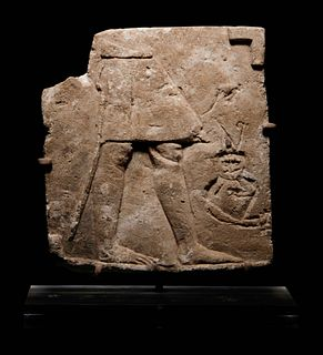 An Egyptian Limestone Sculptor's Model or Votive Relief Height 5 1/4 x width 4 3/4 x depth 1/2 inch.