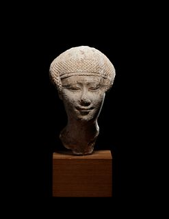 An Egyptian Limestone Head of a Noblewoman Height 4 inches.