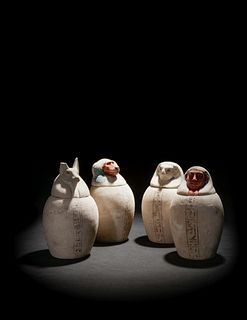 A Set of Four Egyptian Painted Limestone Canopic Jars of the Sons of Horus Height of tallest example 10 1/4 inches.