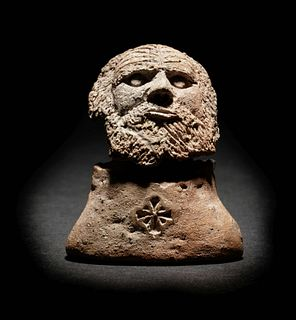 A Romano-Egyptian Terracotta Male Head Height 2 inches.