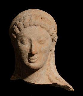 A Greek Terracotta Head Height 4 inches.