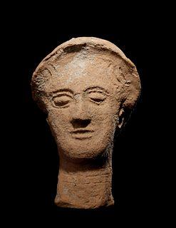 A Greek Terracotta Head Height 10 inches.