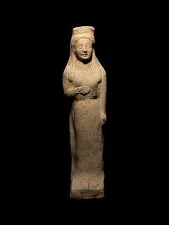 A Greek Terracotta Kore Height 9 1/2 inches.