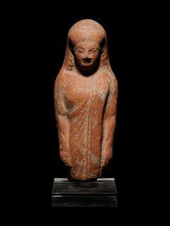 A Greek Terracotta Kore Height 5 7/8 inches.