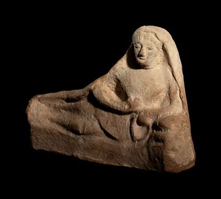 A Greek Terracotta Reclining Figure Height 5 1/2 x width 7 1/2 inches.