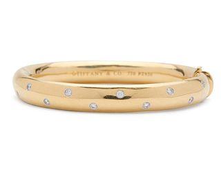 """TIFFANY & CO. 18K Gold, Platinum, and Diamond """"Etoile"""" Bangle Bracelet"""