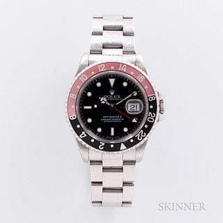 """Rolex GMT Master II Reference 16710 with Box and Papers, c. 1997, stainless steel case with faded aluminum """"Coke"""" bezel, glossy black d"""
