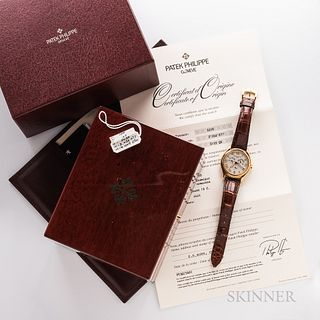 Patek Philippe 18kt Gold Reference 5035 Wristwatch with Boxes and Papers, annual calendar silvered dial with applied roman numerals, st