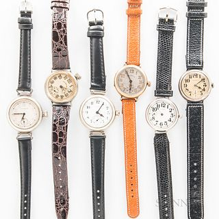 Six Illinois Watch Co. Military Trench Wristwatches, all with arabic numeral dials, one with an offset crown, nickel cases, and one in
