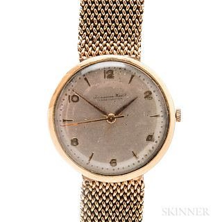 Early IWC 18kt Gold Automatic Wristwatch, c. 1953, oversized silvered dial with arabic even numerals and outer dot minute track, signed