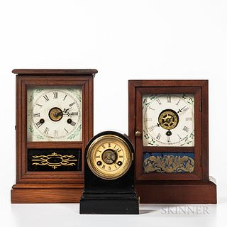"Three American Shelf Clocks, cast iron Terry Clock Co. ""Time-Piece"" with rear label, and two cottage clocks including a Wm. Gilbert wit"