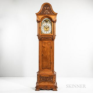 Carved Oak Quarter-chiming Hall Clock, possibly John Ellis and A.H. Davenport case, exaggerated arch-top hood with floral carved decora