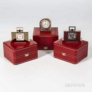 Three Cartier Table or Desk Alarm Clocks, including a limited edition no. 021/500, all with boxes.