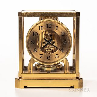 Jaeger-LeCoultre Co. Atmos Clock, no. 12077, 5-in. gilt dial with applied black arabic numerals and hands, 15-jewel movement powered by
