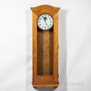 Standard Electric Time Master Clock, birch case with full-length glazed door, wood bezel surrounds the 12-in. metal roman numeral dial