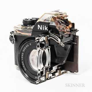 Rare Nikon EM Factory Cut Display Camera, full size camera with clear plastic components on top and bottom to display the complexity of