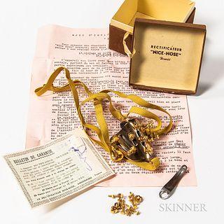 "Original Rectificateur ""Nice-Nose"" with Original Box and Paperwork, gilt formed medical nose with elastic straps, original guarantee ca"