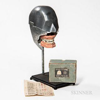 Cast Aluminum Dental Phantom, Columbia Dentoform Corp., adjustable set of hinged dentures with original Columbia cardboard box, mounted