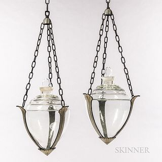Pair of Owens Illinois Art Deco Apothecary Hanging Show Globes, Owens Illinois Glass Company, cast aluminum carriages in typical Art De