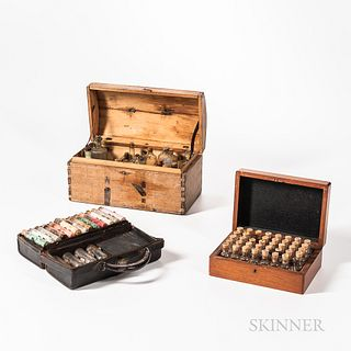 Three Early Traveling Medicine Chests, a 1830s dome-top, dovetailed wood box with eighteen period medicine bottles, leather interior li