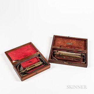 Two Mid-19th Century Stomach Pumps, England and Boston, both housed in fitted hinged mahogany boxes, an embossed brass syringe marked i