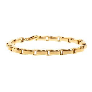 A Heavy 18K Yellow Gold Stirrup Style Bracelet
