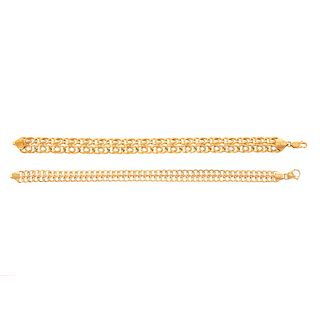 A Pair of 18K & 14K Interlocking Scroll Bracelets