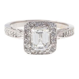 A 1.08 ct Emerald Cut Diamond Halo Ring in 14K