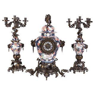 French Japonisme Parcel-Gilt Patinated Bronze Imari Porcelain Clock Garniture