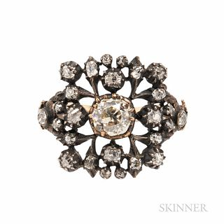 Antique Old Mine-cut Diamond Ring, set with foil-back old mine-cut diamonds, the center diamond weighing approx. 0.50 to 0.60 cts., sil