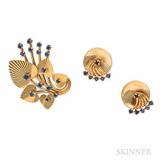 Tiffany & Co. 14kt Gold and Sapphire Suite, the brooch with ribbed leaves set with circular-cut sapphires, earclips with moveable sapph