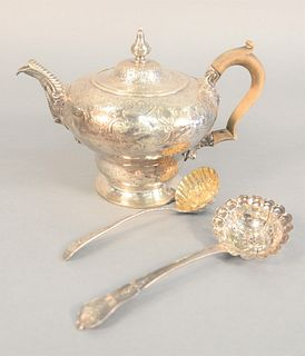 "Three piece lot Georgian silver, teapot with wood handle and foliate spout along with two strainer spoons, probably 18th C., 23.8 t.oz, 6-1/2"" highest"