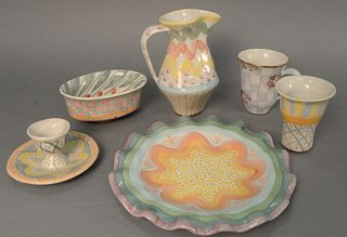 Large group of approximately twenty-eight Mackenzie Childs tableware to include six coffee cups, five scalloped edge plates, one egg cup, one large pi