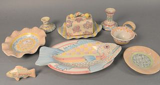 Large group of approximately thirty-six Mackenzie Childs tableware to include three fish platters, six napkin rings, butter plate with cover, large se