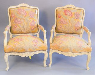 "Pair of Louis XV style fauteuil, needlepoint upholstery, ht. 38 1/4"", wd. 26 1/2 ""."