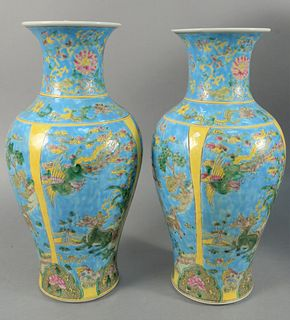 "Pair of Chinese porcelain vases with blue background and dragons, ht. 17-1/2""."