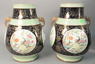 "Pair of Chinese porcelain jars, having four red polychrome panels painted with birds and flowers and animal head handles, ht. 15-1/2""."