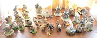 Group of thirty-four Boehm porcelain small figurines, twenty-four Boehm birds and animals along with ten boehm birds on metal bases, a majority stampe