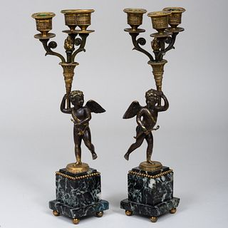 Pair of Patinated Gilt-Bronze and Verde Antico Marble Putto Form Three Light Candelabra