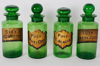 Four Green Glass Apothecary Bottles