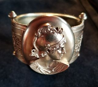 18k gold bangle with figural warrior head