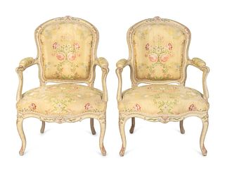 A Pair of Louis XV Yellow-Painted Fauteuils en Cabriolet Height 35 x width 25 x depth 20 inches.