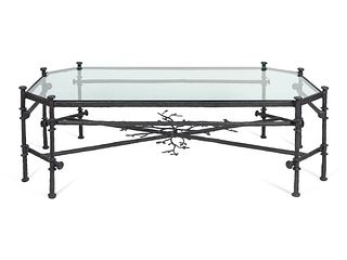 A Contemporary Bronze and Glass Cocktail Table Height 18 x length 58 x width 31 inches.