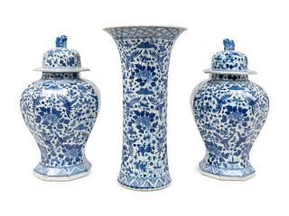 A Chinese Blue and White Porcelain Three-Piece Garniture and a Delft Fluted Vase Height of covered vases 18 x diameter 10 1/2 inches; height of ribbed