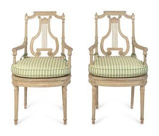 A Pair of Louis XVI Grey-Painted Fauteuils Height 39 x width 23 x depth 21 inches.