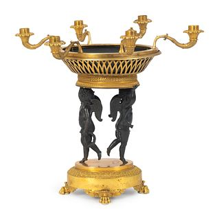 A Louis XVI Style Parcel-Gilt and Patinated Bronze Centerpiece Height 18 1/2 x diameter 18 inches.