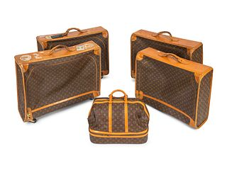 Five Louis Vuitton Suitcases Dimensions: Garment bags: 24 x 28 x 8 inches weekend bag: 12 x 20 x 17 inches.